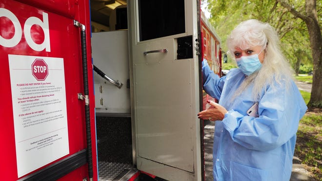 JACKSONVILLE -- Laurie Valasso, who works at OneBlood in Jacksonville, walks into the blood donation bus on July 15. Because of the coronavirus pandemic, OneBlood is experiencing more than a 500% increase in hospital orders for COVID-19 convalescent plasma.