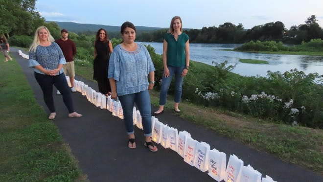 """Lisa Randazzo-Misczuk, Tonya Addy, Andrea Cole, Susan (Guth) Pacconi and Brian Rollman were among the Port Jervis High School Class of 1992 classmates who set up luminaria at last week's """"From Port Jervis With Love"""" gathering to show their support for classmate Paige Bronson Gershman and her family."""