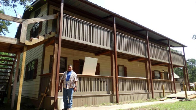 Pastor Roland Nava stands outside the two-story Open Door Soup Kitchen of the Hands Up High ministry in Bastrop County, which is one of the 93 applicants asking for relief grant dollars through the CARES Act.