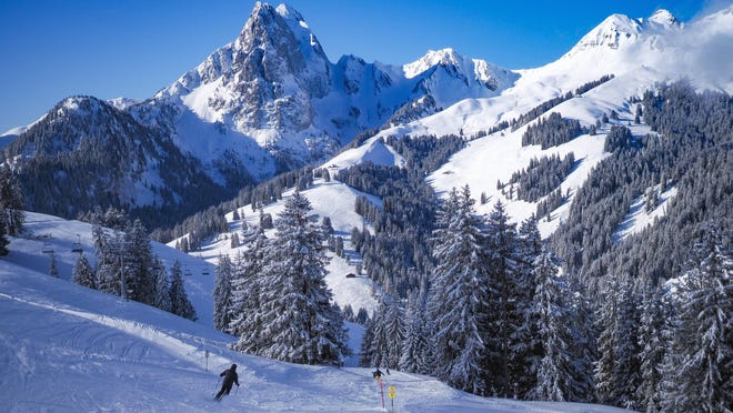 People ski at Eggli, near Gstaad, Switzerland. The resorts around Gstaad are more of a network of ski lifts connecting multiple towns than one bustling base area.