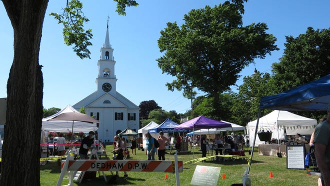 Vendors line the lawn in front of First Parish Church for the first Farmers Market of the season on June 17.