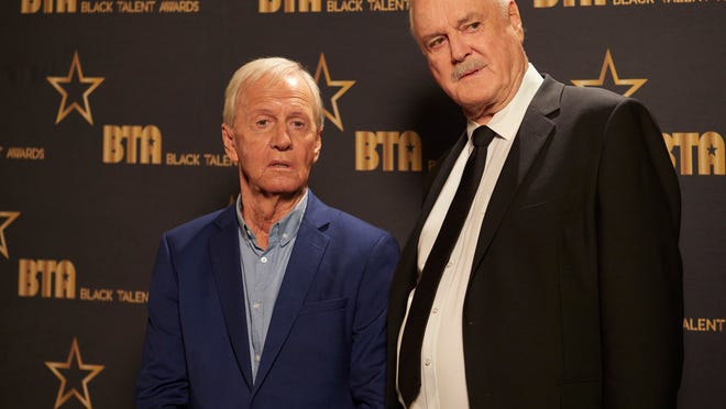 Paul Hogan and John Cleese play versions of themselves.