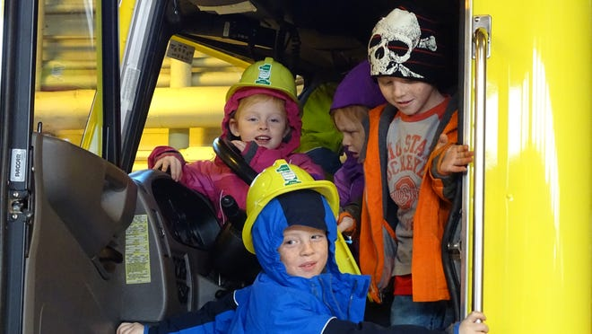 Kids crammed into the cab of a plow truck at the Ohio Turnpike open house in 2016 at the Elmore maintenance garage.