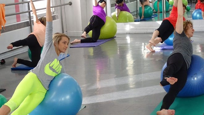 Brooke Buchanan, left, is in her second month of taking Pilates classes. Instructor Laura Tyson, right, said Pilates is an exercise designed to strengthen the core and add flexibility.