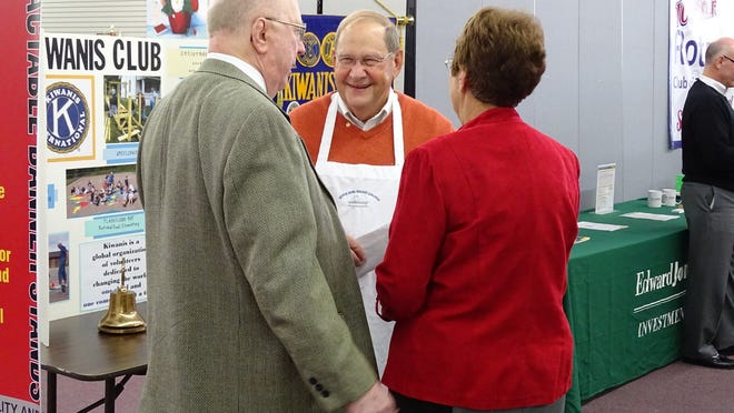 SOUPer Bowl co-founder Bill Factor talks with guest at the 18th annual event Sunday at the Muskingum County Center for Seniors. Along with raising money to feed those in need, Factor said it's a great way to unite the various church denominations in the community.