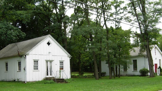 Jacob's Chapel  Meeting House (left) and AME church are all that remains of  the African-American community of  Colemantown in Mount  Laurel. A national historic site marker is to be erected between them Saturday