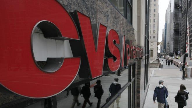 2012 AP photo Pedestrians walk past a CVS store in Chicago in February 2012.