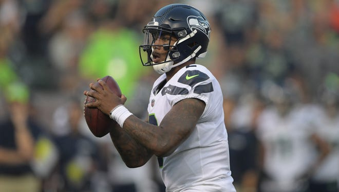 Seattle Seahawks quarterback Trevone Boykin (2) throws a pass against the Oakland Raiders during a NFL football game at Oakland-Alameda County Coliseum.