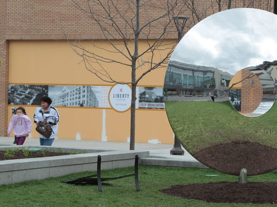 Linda Harrison, of Mason, and her granddaughter, Raianah Ramsey walk past a reflective sculpture on The Square at Liberty Center on their way to a movie at Cobb Liberty Luxury 15 and Cinebistro.