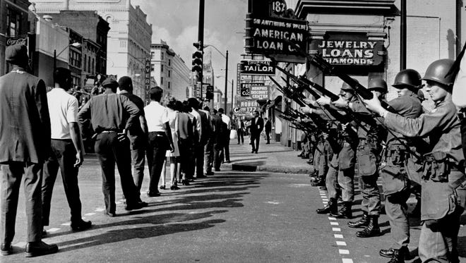 The daily sanitation strike marches resumed March 29, 1968 - one day after rioting left Main and Beale littered with bricks and broken glass and dappled with blood. The city was taking no chances on a repeat of the violence: National Guardsmen blocked off Beale Street.