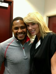 Michael Washington, of Nashville, poses with superstar Taylor Swift during their jury service in Nashville on Monday, Aug. 29, 2016.