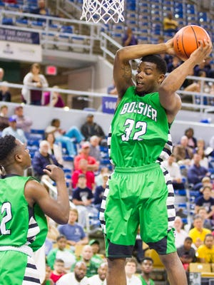 Bossier's Dontaveous Washington gets the rebound against St. Thomas More during the play-off game in the LHSAA Boy's Top 28 Semi-Finals in Lake Charles March 10, 2016.