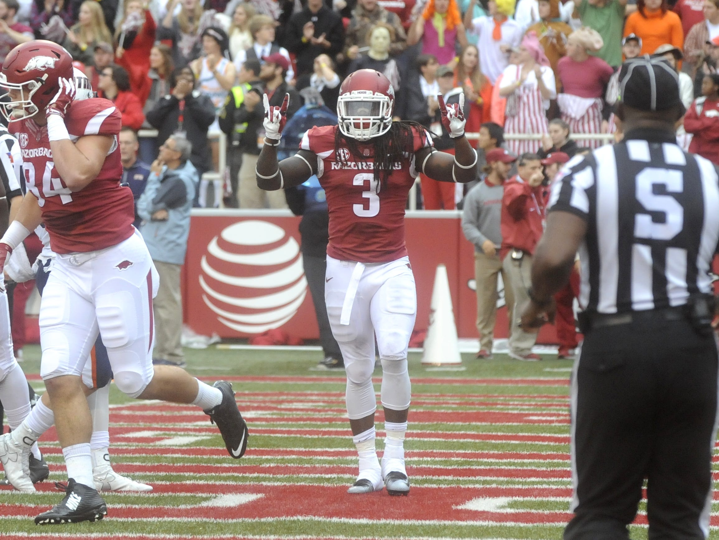 Arkansas' Alex Collins (3) celebrates after a touchdown against Mississippi State.