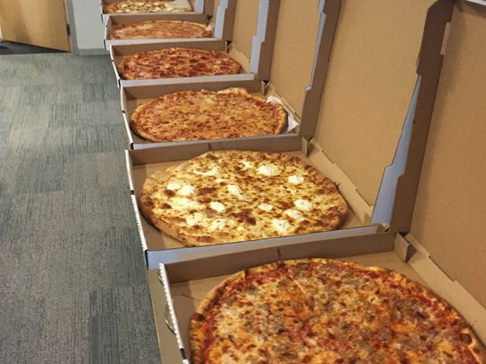 A line of pizza pies in the Naples Daily News newsroom. Journalists everywhere love pizza.