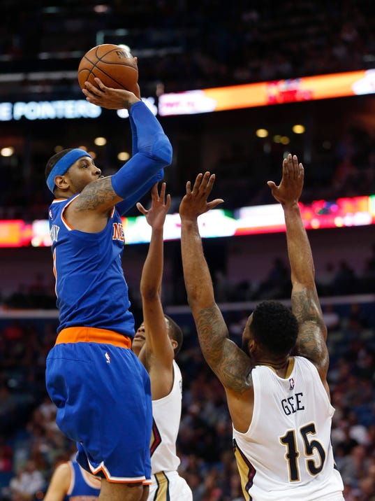 New York Knicks forward Carmelo Anthony (7) shoots over New Orleans Pelicans forward Alonzo Gee (15) in the first half of an NBA basketball game in New Orleans, Monday, March 28, 2016. (AP Photo/Gerald Herbert)