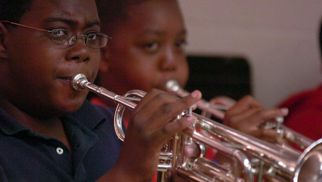 Instruments givento Play It Again are passed on to local students.
