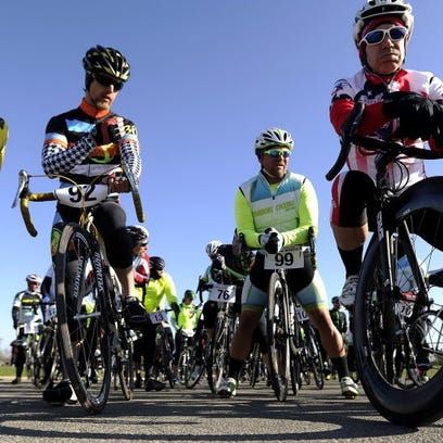 Cyclists wait at the starting line for the start of