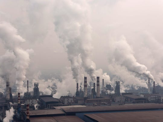 Steel factories belch smoke on Jan. 20, 2016 in Tangshan, China. Air pollution is one of the main environmental causes of deaths worldwide, a report states.
