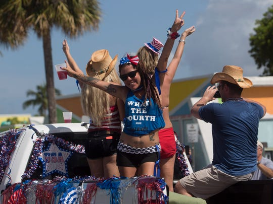 Christina Stojanovski, representing the Lani Kai, participates in the Fourth of July Parade on Fort Myers Beach Monday.