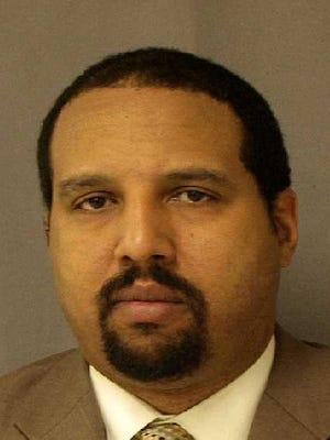 Marc Cunningham is shown in his booking mugshot on Nov. 5, 2010. He helped the government in its prosecution of former Detroit mayor Kwame Kilpatrick and his father, Bernard Kilpatrick. Cunningham pleaded guilty to conspiracy in 2010.