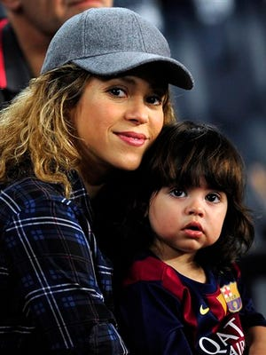 Colombian singer Shakira, left, holds her son Milan prior to the Spanish La Liga soccer match between FC Barcelona and Eibar at the Camp Nou stadium against Eibar in Barcelona, Spain. Shakira is partnering with Fisher-Price to launch a collection of baby toys.