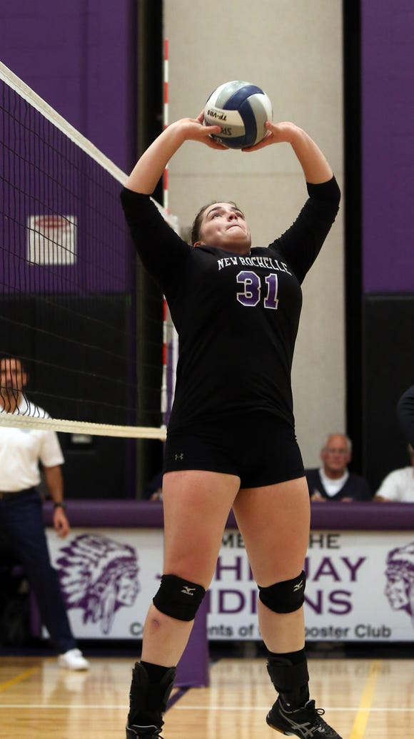 New Rochelle's Adeline Cullom (31) sets the ball for a teammate during state regional semifinal volleyball match against Binghamton at John Jay Cross River High School in Cross River Nov. 8, 2017.