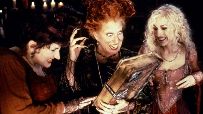 Kathy Najimy (left), Bette Midler and Sarah Jessica Parker star as 17th Century witches who accidentally find themselves in modern day Salem, Massachusetts in HOCUS POCUS.  Credit: Buena Vista Pictures.