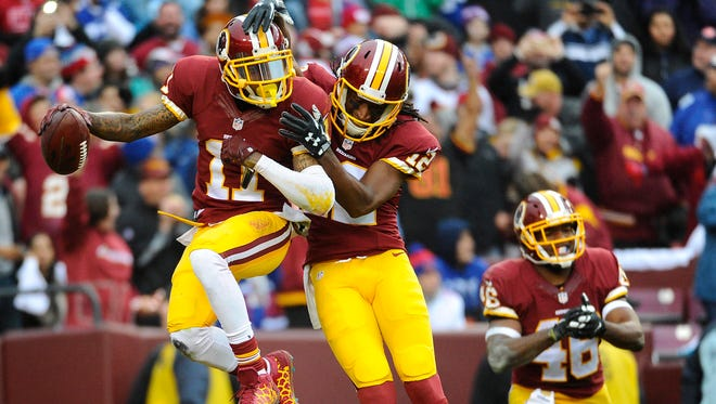 Washington Redskins wide receiver DeSean Jackson (11) celebrates with wide receiver Andre Roberts (12) after scoring a touchdown against the New York Giants during the first half at FedEx Field.