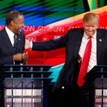 Ben Carson, left, and Donald Trump laugh during the CNN Republican presidential debate at the Venetian Hotel & Casino on Tuesday Dec. 15 in Las Vegas.