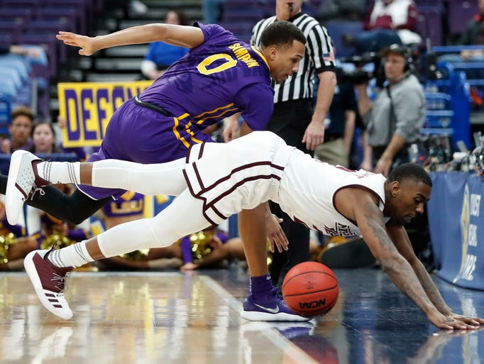 Mississippi State's Eli Wright, bottom, is unable to