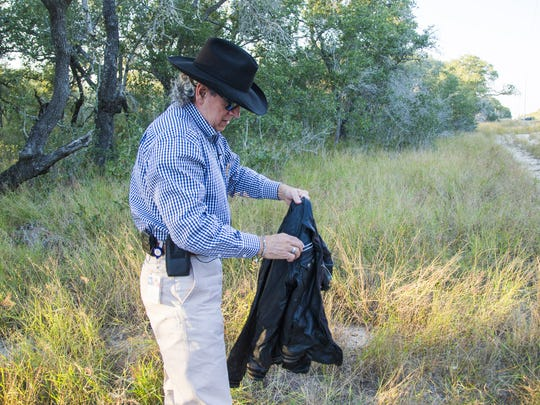 Brooks County Sheriff Benny Martinez finds a jacket on a ranch frequently used by border crossers south of Falfurrias, Texas.