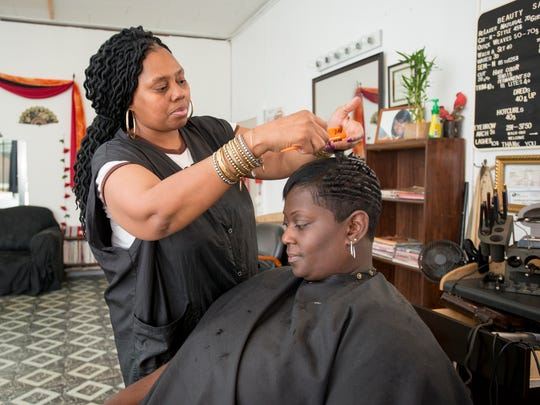 Tiffany Phifer, left, styles Melissa Anderson's hair at The Network Beauty & Barbershop in Brownsville on Thursday, November 16, 2017.