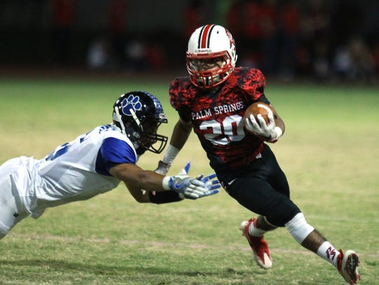 Palm Springs High School's Nick Reyes Foster evades