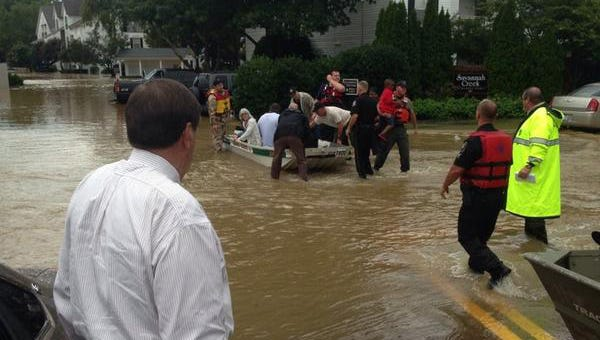 DeSoto County Sheriff Bill Rasco (foreground) at flooded Savannah Creek apartments in Southaven, Miss.