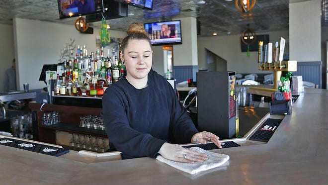 Victory Point bartender Kristen Callahan, 25, of Quincy, pictured in March.
