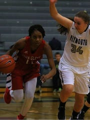 John Glenn's Nadia Reed dribbles past Plymouth's Rebecca
