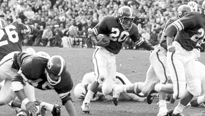 Sherm Lewis played almost every minute of every game as a halfback and defensive back during his three seasons with the Spartans. In 1963, he was third in Heisman Trophy voting.
