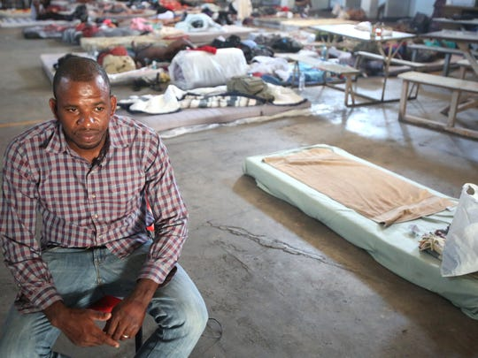 Emilio Louil, 31, a Spanish-speaking Haitian migrant serves as a translator between the Mexican staff of a migrant shelter and French-speaking men from Haiti and the Democratic Republic of Congo who plan to go to the United States.