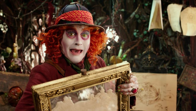 "Johnny Depp portrays the Hatter in a scene from ""Alice Through The Looking Glass."" In this image released by Disney, Johnny Depp portrays the Hatter in a scene from ""Alice Through The Looking Glass."""