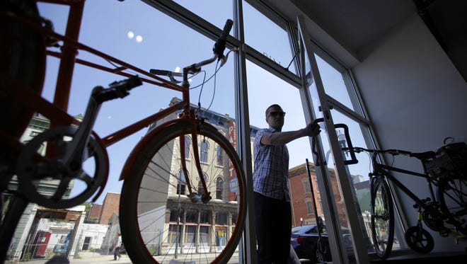 A customer walks into Reser Bicycle Outfitters at 1419 Vine Street in Over-the-Rhine.
