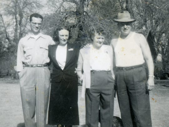 Charles and Myrtle Couche, right, at home on the Rivercrest Farm with daughter Gladys and husband.