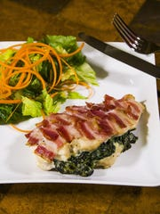 Stuffed chicken breast with creamed spinach and bacon shingles.