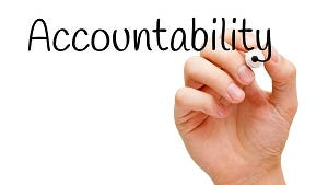 Hand writing Accountability with black marker on transparent wipe board.