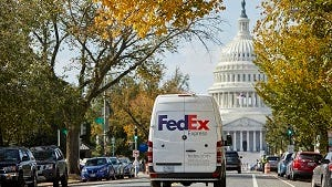 A FedEx Express delivery van approaches the Capitol.