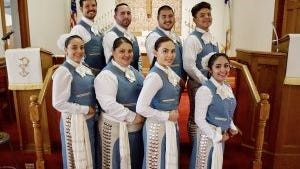 Young singers with the Mariachi San Pablo group spread the gospel with their lively, yet traditional music.