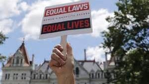 A sign during a June 2013 women's rights rally at the Capitol in Albany, in support of the 10-point Women's Equality Act.