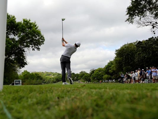 Rory McIlroy, of Northern Ireland, hits from the third tee during round-robin play against Soren Kjeldsen of Denmark at the Dell Technologies Match Play golf tournament at Austin County Club, Wednesday, March 22, 2017, in Austin, Texas. (AP Photo/Eric Gay)