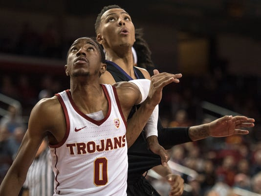 Southern California guard Shaqquan Aaron, front, and Washington forward Dominic Green wait for a rebound during the first half of an NCAA college basketball game Friday, Dec. 29, 2017, in Los Angeles. (AP Photo/Kyusung Gong)