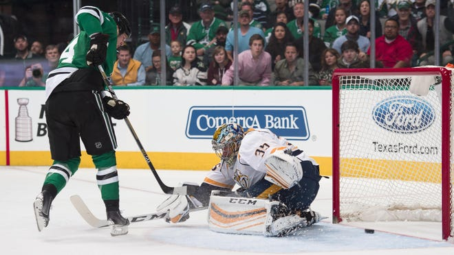 Stars left wing Jamie Benn (14) scores a breakaway goal against Predators goalie Pekka Rinne (35) during the first period Tuesday.