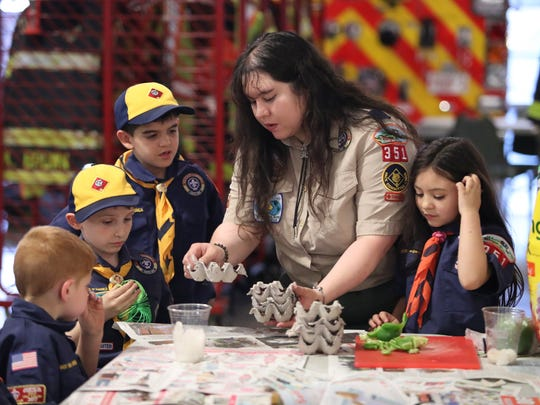 "Christina Gardner helps run a Cub Scout pack meeting as her daughter Alexandra ""A.J."" Gardner, 6, participates at her side as the first girl in a Delaware to join a Cub Scout group."